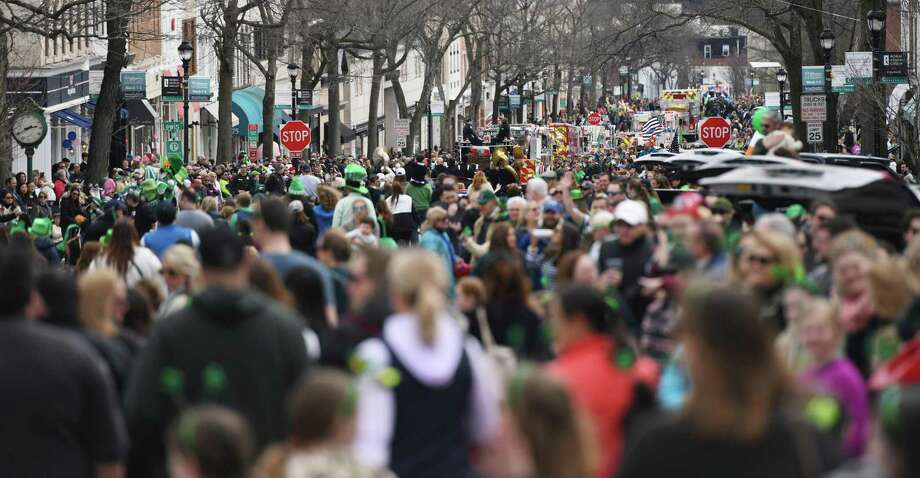 Greenwich Avenue is packed with people as participants march in the annual St. Patrick's Day Parade in Greenwich, Conn. Sunday, March 24, 2019. Presented by the Greenwich Hibernian Association, the parade featured Irish bagpipe music, Irish dancers, floats from many local organizations, as well as Greenwich police, fire and EMS. Monsignor J. Peter Cullen, from St. Michael the Archangel Parish in Greenwich, served as the parade's Grand Marshal. Photo: Tyler Sizemore / Hearst Connecticut Media / Greenwich Time