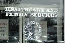 A photo of the front door to the Department of Healthcare and Family Services building in Springfield.
