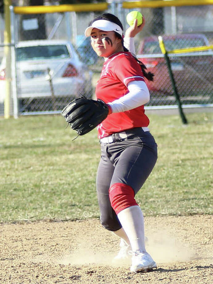 Alton shortstop Tami Wong, shown throwing to first for an out Thursday at Roxana, had five hits Saturday in the Redbirds' doubleheader split with Jersey at Alton High in Godfrey. Photo: Greg Shashack / The Telegraph