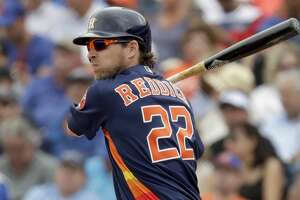 Houston Astros' Josh Reddick singles during the third inning of an exhibition spring training baseball game against the New York Mets Monday, Feb. 25, 2019, in West Palm Beach, Fla. (AP Photo/Jeff Roberson)