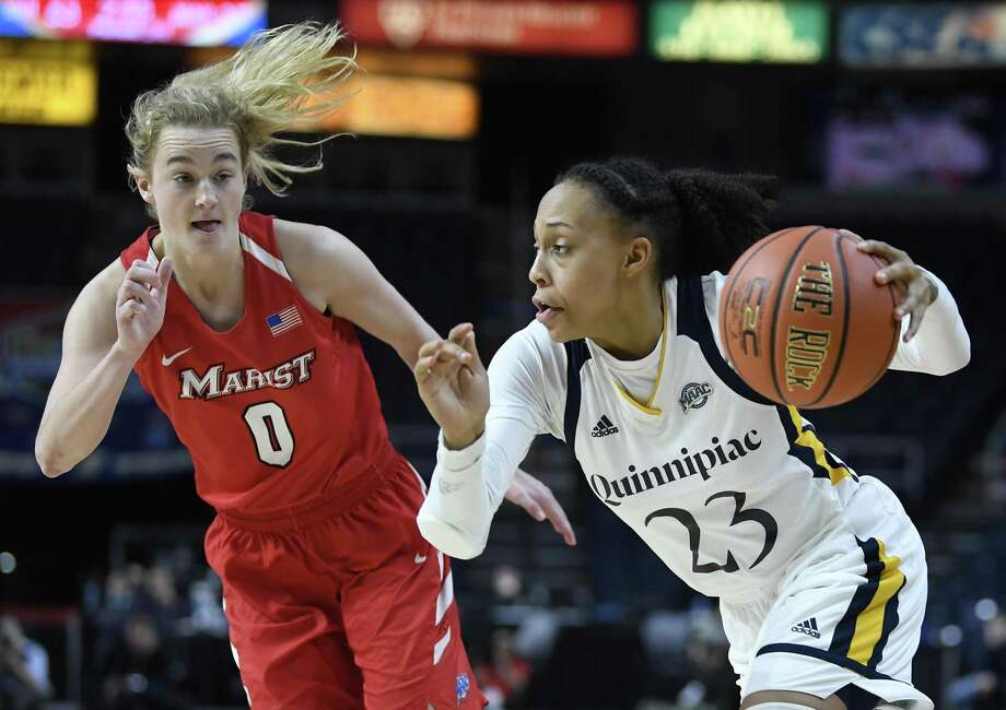 Marist guard Grace Vander Weide, left, defends against Quinnipiac guard Brittany Martin during the MAAC Tournament championship game March 11. Photo: Hans Pennink / Associated Press / Copyright 2019 The Associated Press. All rights reserved.