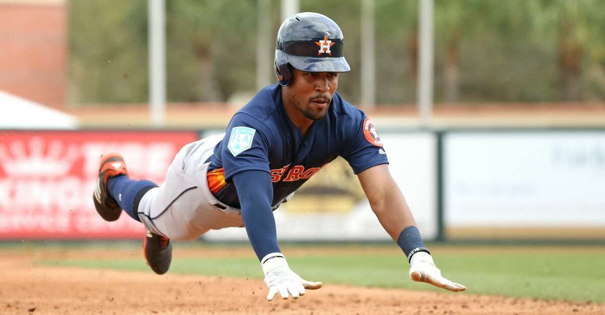 PHOTOS: Top prospects Houston Astros center fielder Tony Kemp (18) slides safely into third base during the sixth inning of a Major League Baseball spring training game against the Miami Marlins at Roger Dean Chevrolet Stadium Tuesday, Feb. 26, 2019 in Jupiter, Fla. (David Santiago/Miami Herald/TNS) Browse through the photos to see the Astros' top prospects ahead of the 2019 season.