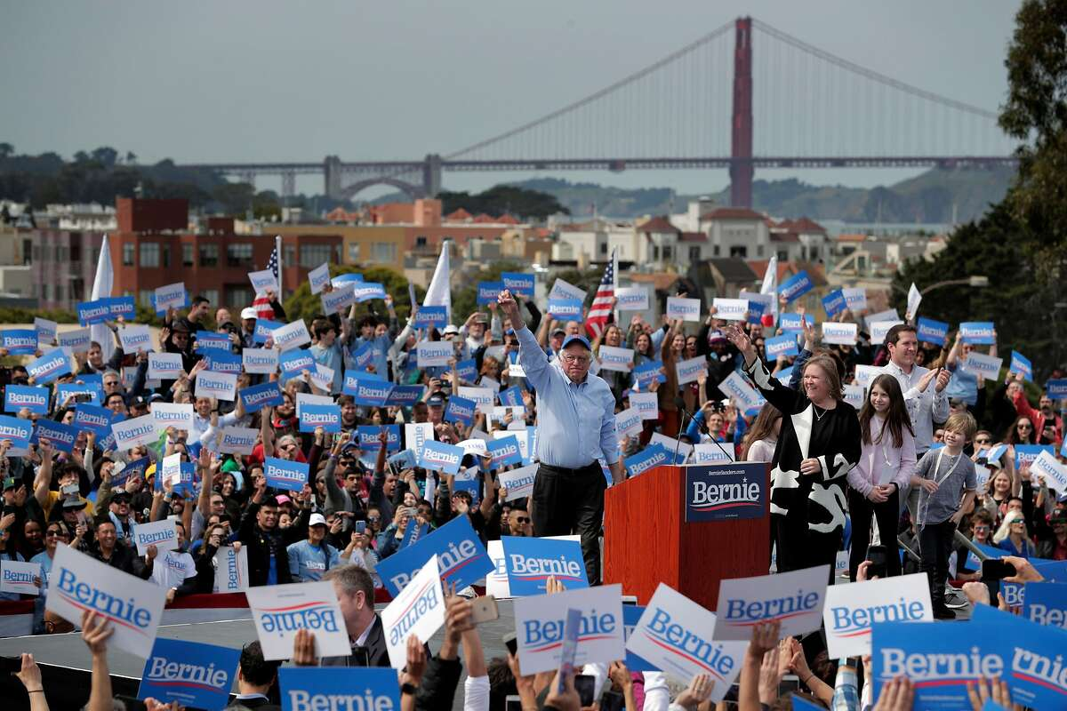 Democratic presidential candidate Sen. Bernie Sanders, I-Vt., greets supporters as he takes the stage during a rally at Great Meadow Park at Fort Mason in San Francisco, Calif., on Sunday, March 24, 2019.