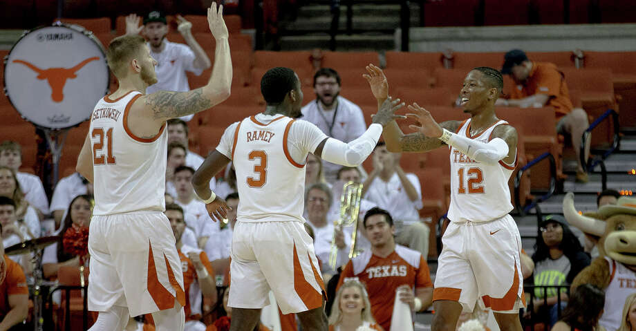 Texas guard Kerwin Roach II (12) celebrates a score with forward Dylan Osetkowski (21) and guard Courtney Ramey (3) during an NCAA college basketball game in the second round of the NIT on Sunday, March 24, 2019, in Austin, Texas. (Nick Wagner/Austin American-Statesman via AP) Photo: Nick Wagner/Associated Press