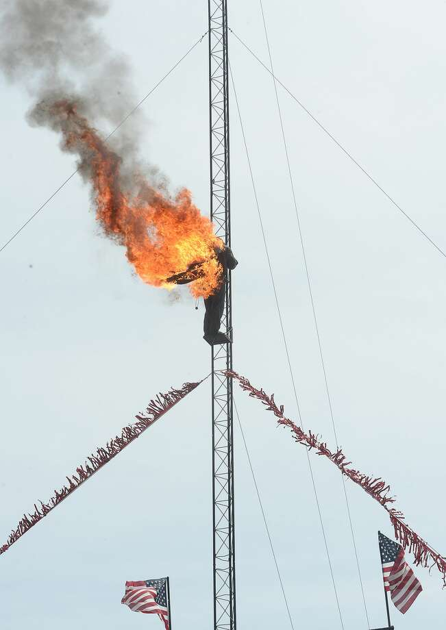 Clark Kocourek opens the Great American High Dive Show with a fiery stunt at the YMBL South Texas State Fair Saturday. Photo taken Saturday, March 23, 2019 Kim Brent/The Enterprise Photo: Kim Brent/The Enterprise