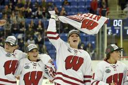 Wisconsin's Maddie Rowe waves her championship towel after her team defeated Minnesota for the NCAA Division I women's Frozen Four championship Sunday in Hamden.