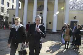 Robert Mueller and his wife, Ann, leave church services as the nation began to digest a released summary of his findings.