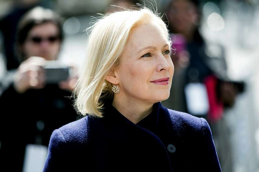 Sen. Kirsten Gillibrand, D-N.Y., listens to actress Connie Britton speak before taking the stage to deliver a speech at the kickoff of her presidential campaign, Sunday, March 24, 2019, near the Trump International Hotel and Tower in New York. (AP Photo/Julius Constantine Motal)