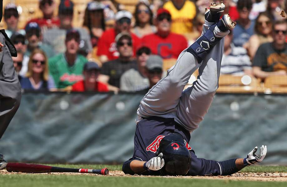 Cleveland's Jose Ramirez tumbles after fouling a ball off his left knee. He left the field on a cart, but X-rays were negative. Photo: Sue Ogrocki / Associated Press