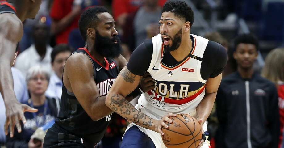 New Orleans Pelicans forward Anthony Davis (23) is defended by Houston Rockets guard James Harden, left, during the first half of an NBA basketball game in New Orleans, Sunday, March 24, 2019. (AP Photo/Tyler Kaufman) Photo: Tyler Kaufman/Associated Press