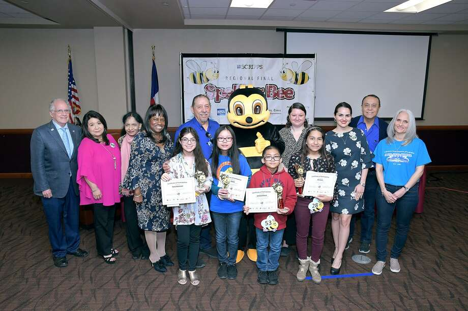 The top four finishers in the 2019 Scripps Regional Final Spelling Bee held Saturday at the Zaffirini Success Center at TAMIU pose with organizers and sponors of the event. The top four finishers, from fourth to first place, were Alynna Montemayor, Kayla Vu, Emmanuel Rimocal and Mia Cuevas. Photo: Cuate Santos /Laredo Morning Times / Laredo Morning Times