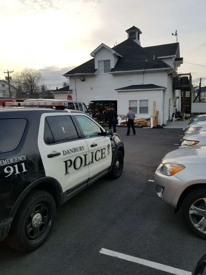 A van hit a building at 39 New St.in Danbury the evening of March 24, 2019, according to the Danbury Fire Department. The accident caused severe damage to the building — a house owned by the Philadelphia Pentecostal Church, and used as a rectory. The van's driver was uninjured. Photo: Contributed / Danbury FIre Department