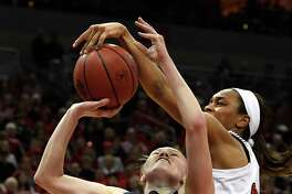 Louisville guard Asia Durr (25) attempts to block the shot of Michigan guard Nicole Munger (10) during the first half of a second-round game in the NCAA women's college basketball tournament in Louisville, Ky., Sunday, March 24, 2019. (AP Photo/Timothy D. Easley)