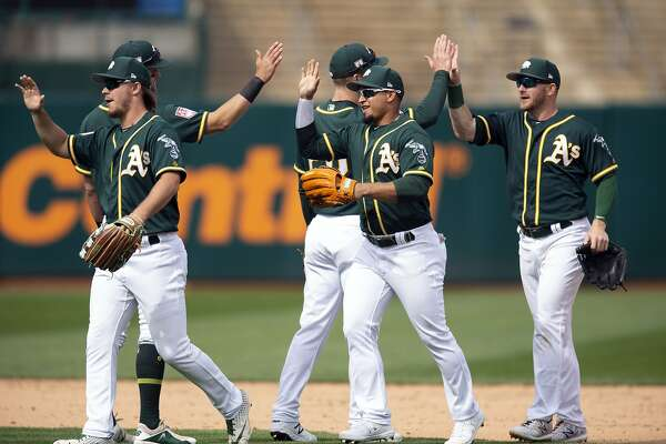 Strong outings on the mound for A's, Giants; Oakland wins 5-0