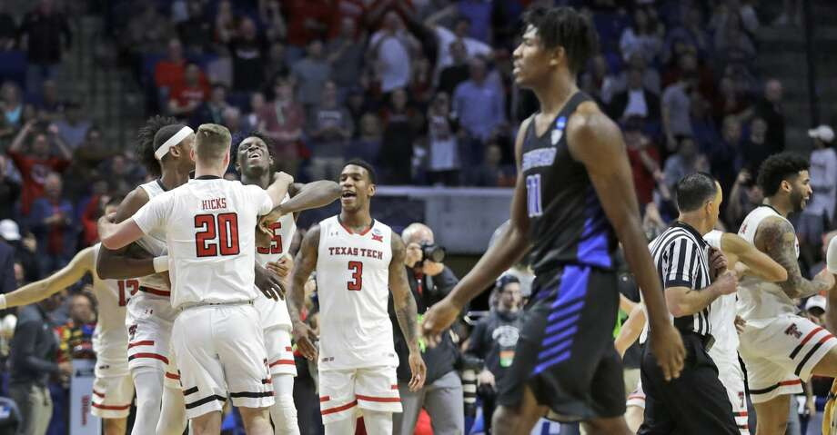 Members of Texas Tech celebrate as Buffalo's Jeenathan Williams walks past in the foreground at the end of a second round men's college basketball game in the NCAA Tournament Sunday, March 24, 2019, in Tulsa, Okla. Texas Tech won 78-58. (AP Photo/Jeff Roberson) Photo: Jeff Roberson/Associated Press