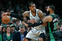 Boston Celtics' Marcus Morris (13) defends against San Antonio Spurs' LaMarcus Aldridge (12) during the first half of an NBA basketball game in Boston, Sunday, March 24, 2019 (AP Photo/Michael Dwyer)