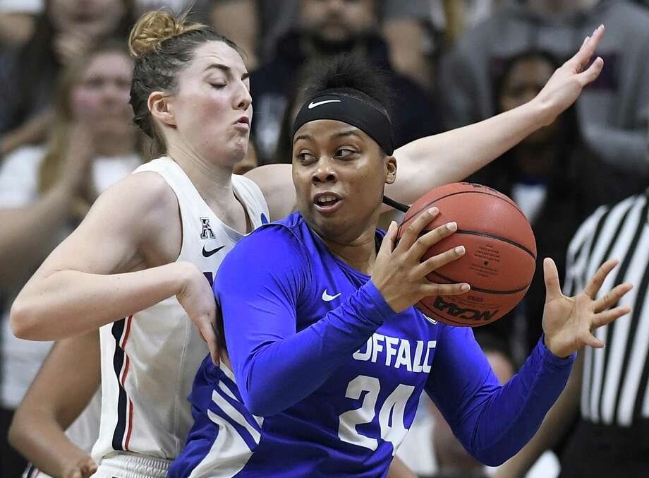 Buffalo's Cierra Dillard, right, is guarded by Connecticut's Katie Lou Samuelson during the second half of a second-round women's college basketball game in the NCAA tournament Sunday, March 24, 2019, in Storrs, Conn. (AP Photo/Jessica Hill) Photo: Jessica Hill / Associated Press / Copyright 2019 The Associated Press. All rights reserved