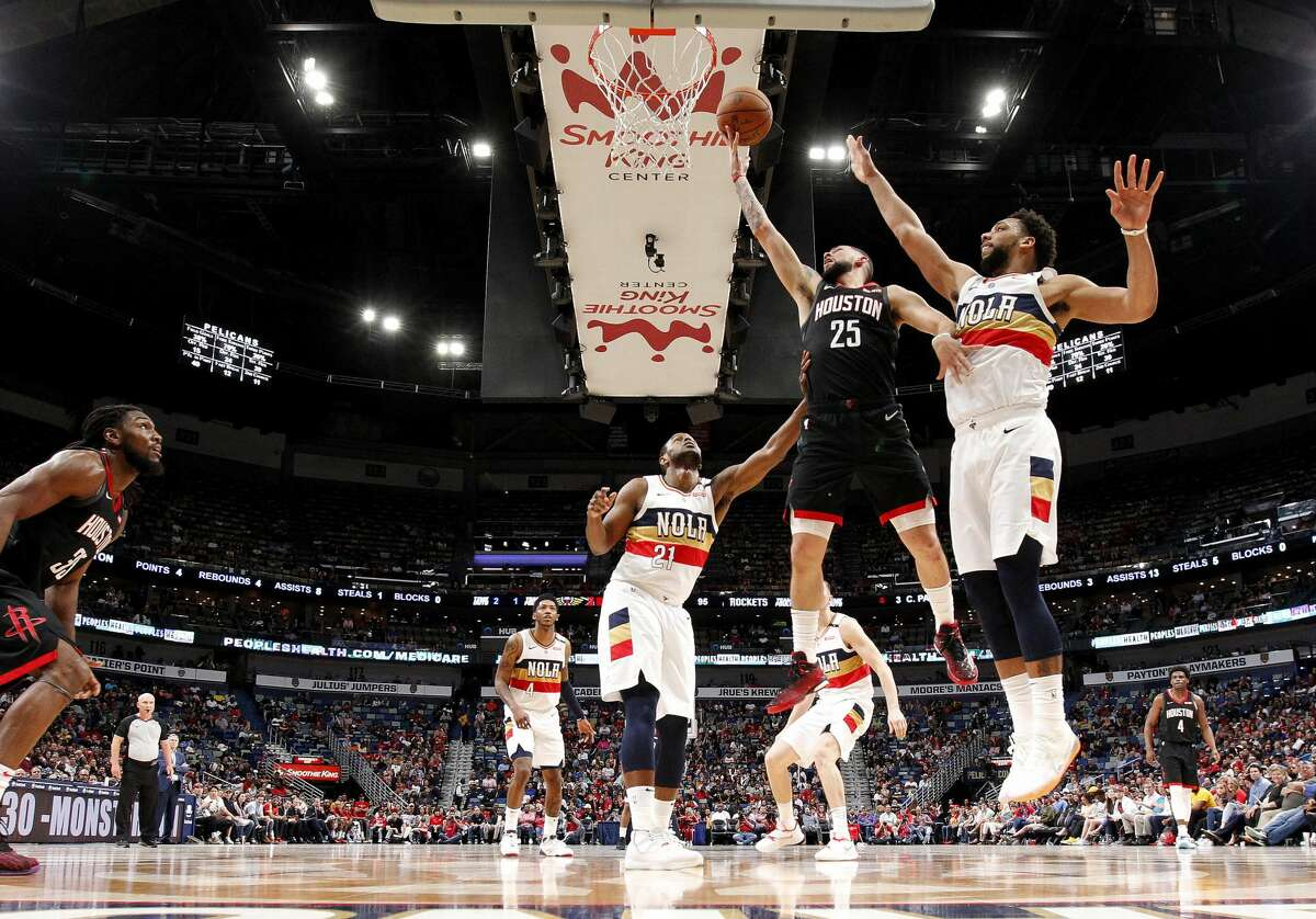 Houston Rockets guard Austin Rivers (25) shoots in front of New Orleans Pelicans center Jahlil Okafor, right, during the second half of an NBA basketball game in New Orleans, Sunday, March 24, 2019. The Rockets won 113-90. (AP Photo/Tyler Kaufman)