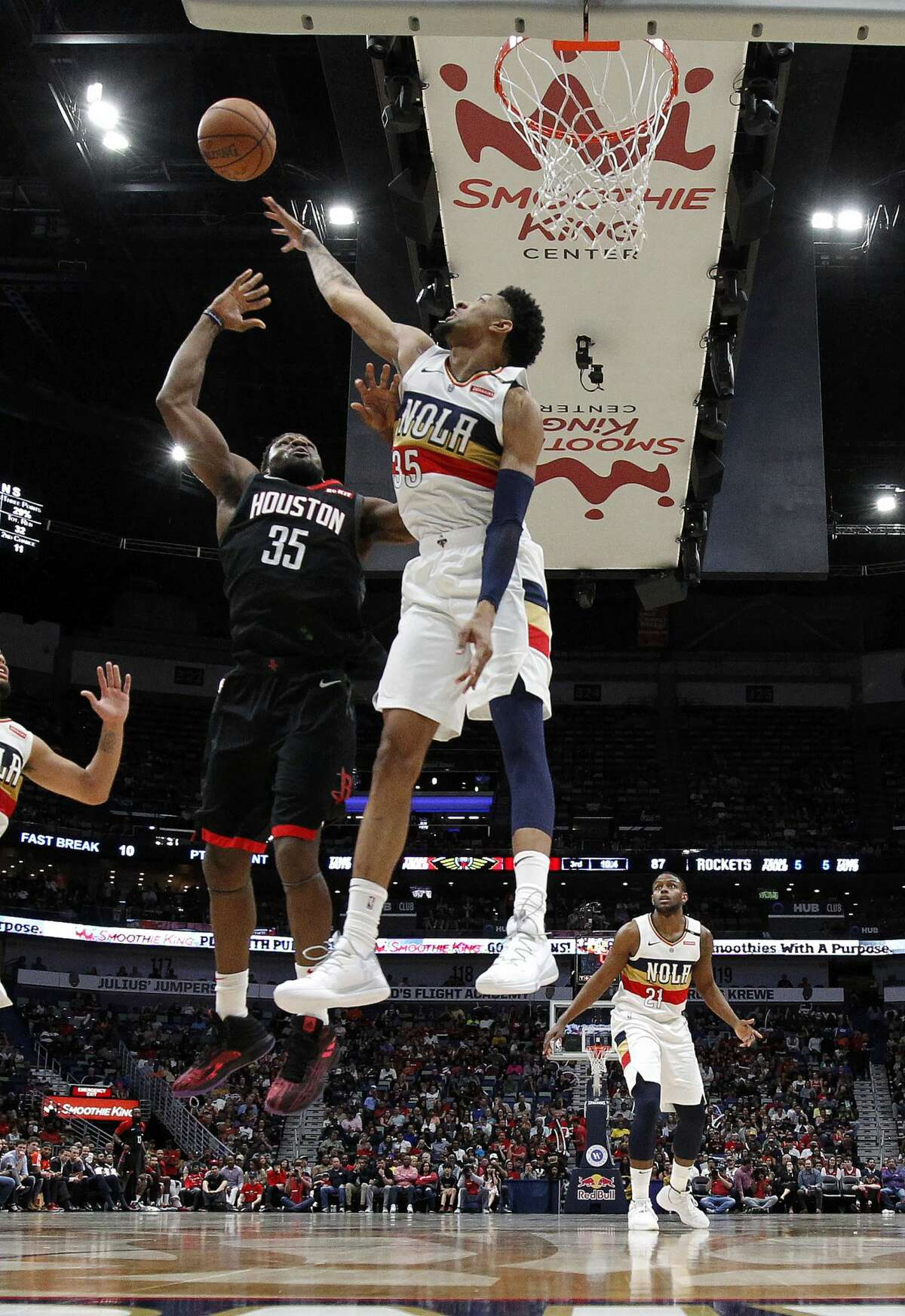 New Orleans Pelicans forward Christian Wood (35) reaches for the ball in front of Houston Rockets forward Kenneth Faried (35) during the second half of an NBA basketball game in New Orleans, Sunday, March 24, 2019. The Rockets won 113-90. (AP Photo/Tyler Kaufman)