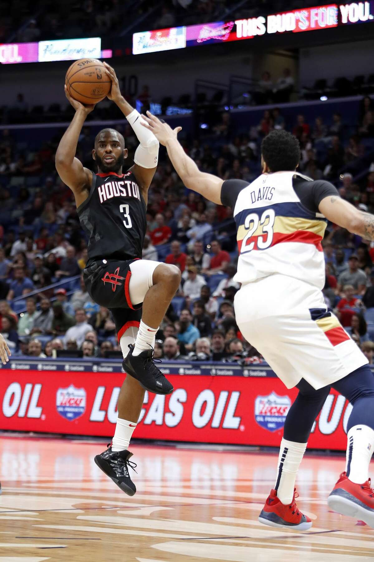 Houston Rockets guard Chris Paul (3) passes the ball in front of New Orleans Pelicans forward Anthony Davis (23) during the first half of an NBA basketball game in New Orleans, Sunday, March 24, 2019. (AP Photo/Tyler Kaufman)
