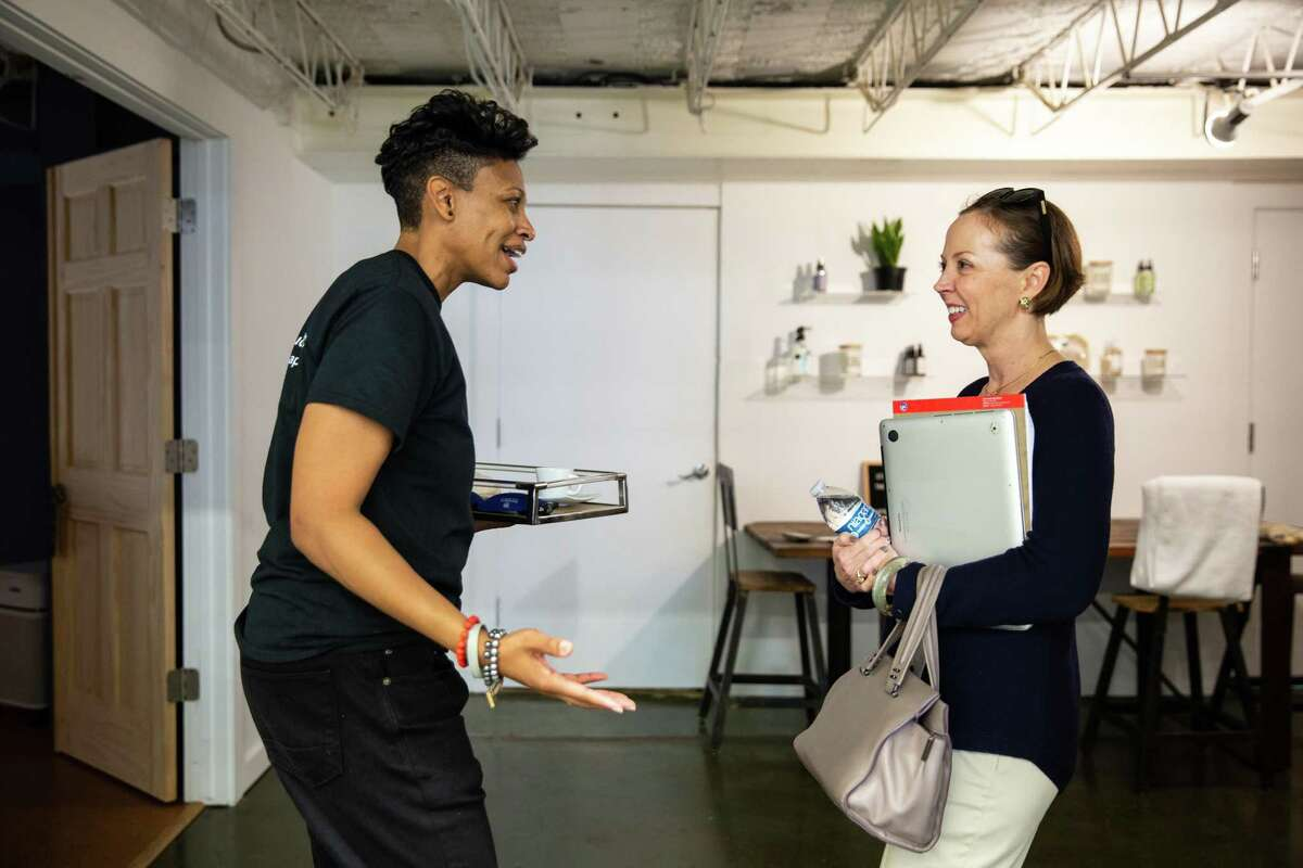 Khaliah Guillory, founder and President of Nap Bar, left, chats with Holly Smith, who popped in from the business next door to check out the Nap Bar.