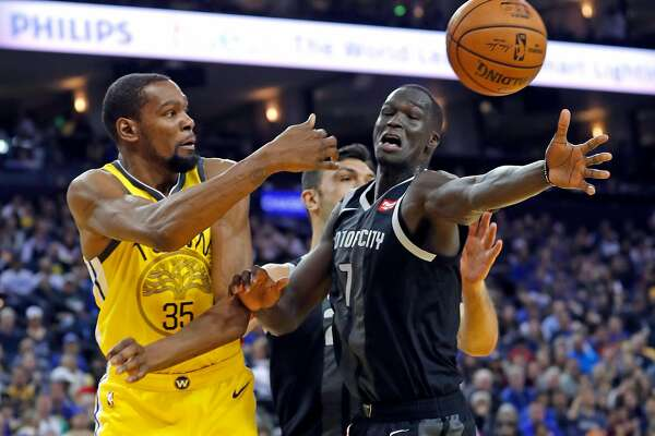 51990be57892 1of3Golden State Warriors  Kevin Durant passes against Detroit Pistons   Thon Maker in 2nd quarter during NBA game at Oracle Arena in Oakland