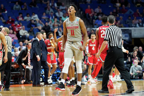 THIS IS A TEST University of Houston's basketball team reacts to the final seconds of the second round of the NCAA tournament against Ohio State on Sunday, March 24, 2019 in Tulsa.