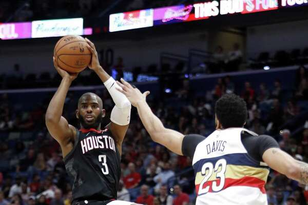 Rockets guard Chris Paul looks to pass in front of Anthony Davis. Paul had a game-high 13 assists.