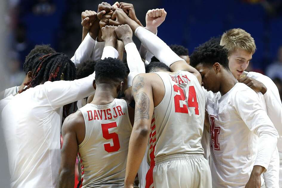 Houston Cougars get together before they take on Ohio State during the second round of NCAA playoffs at BOK Center in Tulsa on Sunday, March 24, 2019.