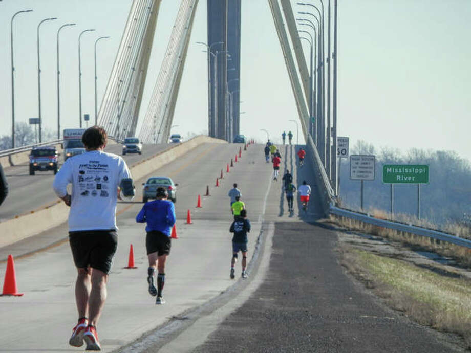 Runners approach the Clark Bridge at the 9th Annual Alton Half Marathon & 5K Run/Walk on Saturday. Photo: Andrew Malo | For The Telegraph