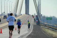 Runners approach the Clark Bridge at the 9th Annual Alton Half Marathon & 5K Run/Walk on Saturday.
