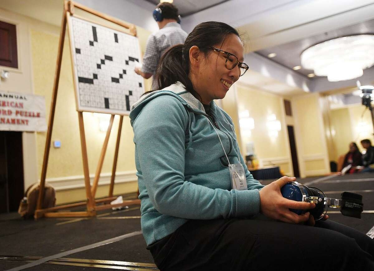 Lily Geller, of Brooklyn, NY, smiles as she awaits the announcement of her victory in the C division at the 42nd Annual American Crossword Puzzle Tournament at the Stamford Marriott in Stamford, Conn. on Sunday, March 24, 2019.