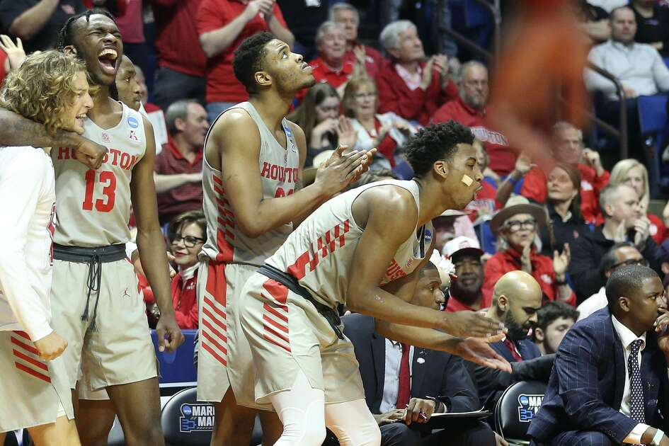 Houston Cougars bench celebrates Houston's win over Ohio State during the second round of NCAA playoffs at BOK Center in Tulsa on Sunday, March 24, 2019.