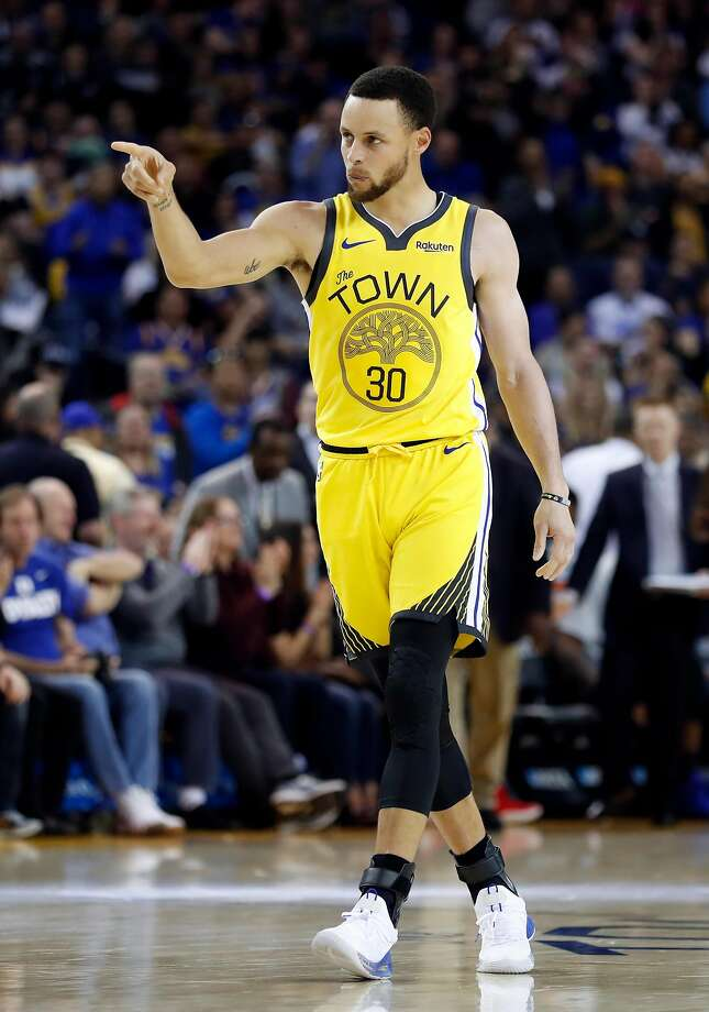 Golden State Warriors' Stephen Curry points during Warriors' 121-114 win over Detroit Pistons during NBA game at Oracle Arena in Oakland, Calif., on Sunday, March 24, 2019. Photo: Scott Strazzante / The Chronicle