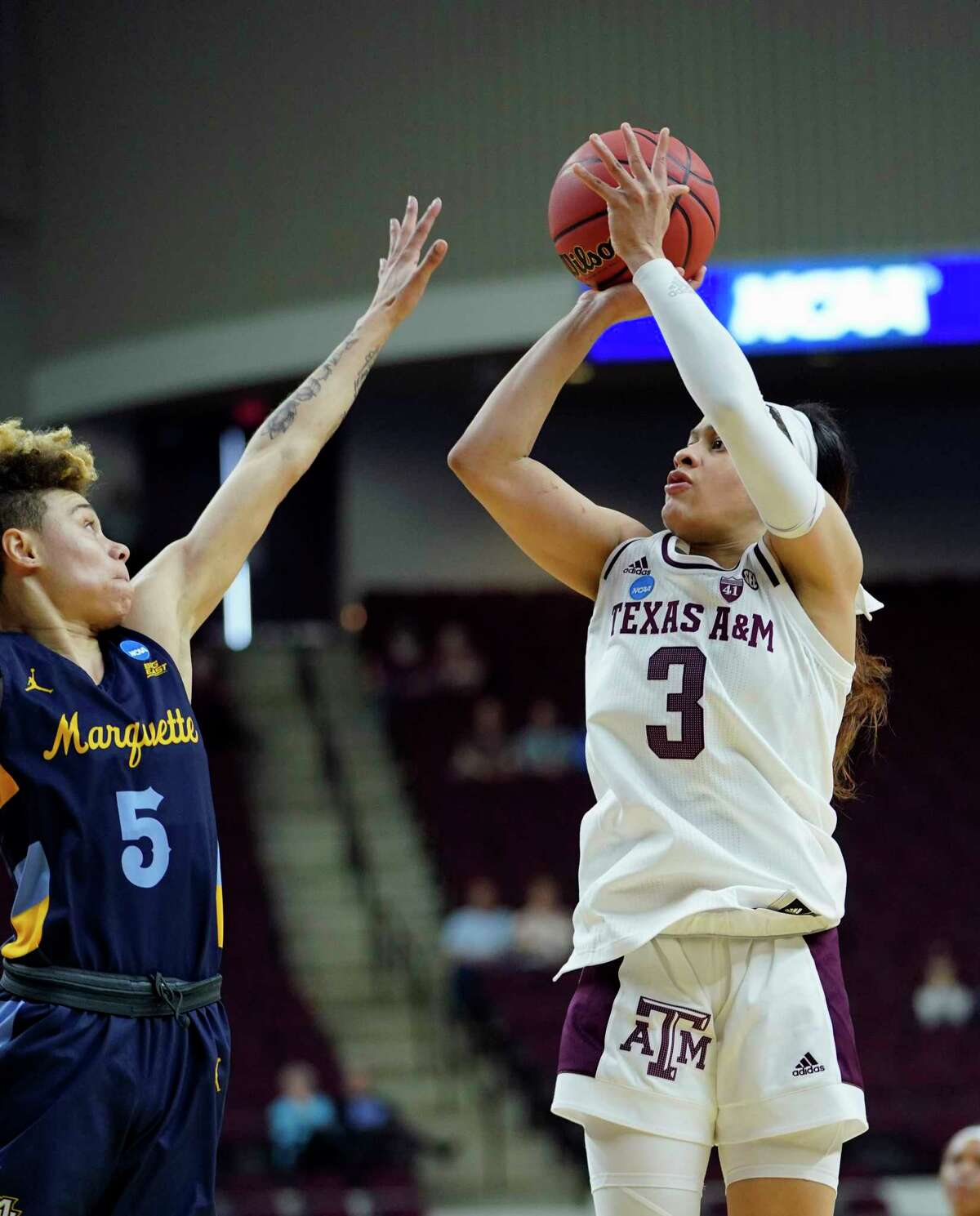Texas A&M's Chennedy Carter (3) shoots as Marquette's Natisha Hiedeman (5) defends during the second half of a second round women's college basketball game in the NCAA Tournament Sunday, March 24, 2019, in College Station, Texas. Texas A&M won 78-76. (AP Photo/David J. Phillip)