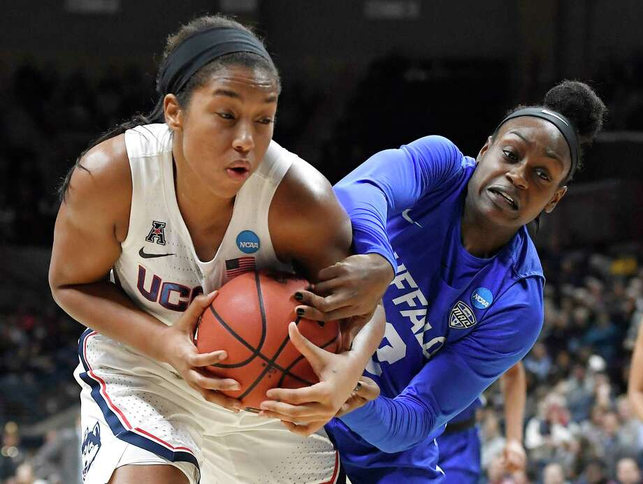 Buffalo's Brittany Morrison, right, pressures Connecticut's Megan Walker during the first half of a second-round women's college basketball game in the NCAA tournament Sunday, March 24, 2019, in Storrs, Conn. (AP Photo/Jessica Hill) Photo: Jessica Hill / Copyright 2019 The Associated Press. All rights reserved