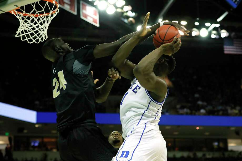 COLUMBIA, SOUTH CAROLINA - MARCH 24: Tacko Fall #24 of the UCF Knights blocks Zion Williamson #1 of the Duke Blue Devils during the second half in the second round game of the 2019 NCAA Men's Basketball Tournament at Colonial Life Arena on March 24, 2019 in Columbia, South Carolina. (Photo by Kevin C.  Cox/Getty Images) Photo: Kevin C. Cox / 2019 Getty Images