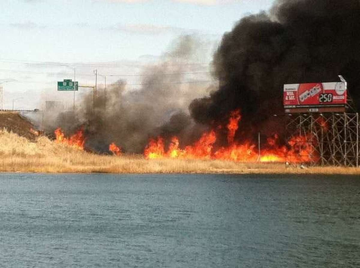 A large brush fire covered I-91 North near exit 8 on Feb. 8, 2012.