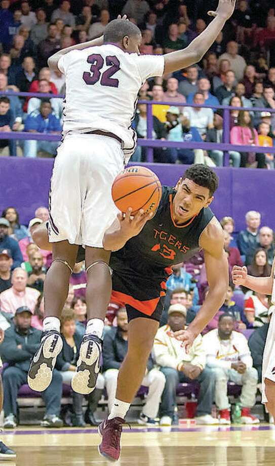 Former Edwardsville Tiger Mark Smith (13) is fouled by Belleville West forward EJ Liddell (32) during the 2017 playoffs in Collinsville. The pair, two of the state's top prep stars of recent seasons opted for out-of-state schools, Liddell, a senior at West, chose Ohio State in October and Smith is at Missouri, after transferring following his freshman season at Illinois. Photo: Telegraph File Photo