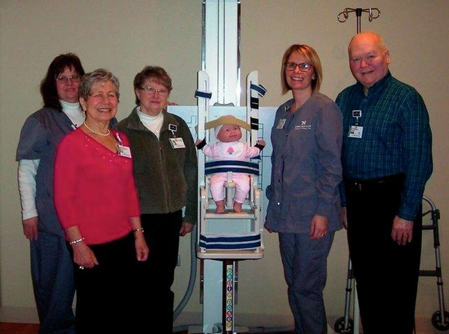 From left, Rita Sheehan, Imaging Services supervisor; Beth Daniels, volunteer; Joyce Thompson, volunteer; Jody Bonomo, Diagnostic Radiology tech, and Bob LaFontaine, volunteer, surround a specialized positioning chair that is helping children receive X-rays more comfortably thanks to support from MidMichigan Medical Center - Gladwin volunteers. (Photo provided)