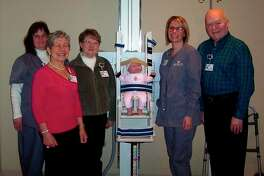 From left,Rita Sheehan, Imaging Services supervisor; Beth Daniels, volunteer; Joyce Thompson, volunteer; Jody Bonomo, Diagnostic Radiology tech, and Bob LaFontaine, volunteer, surround a specialized positioning chair that is helping children receive X-rays more comfortably thanks to support from MidMichigan Medical Center - Gladwin volunteers. (Photo provided)