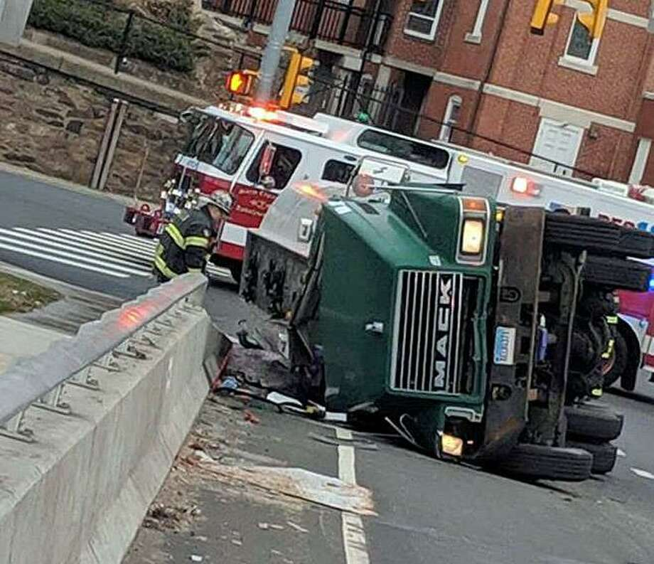 A tanker trailer loaded with gasoline has tipped over on Route 34 near the James Atwater Bridge leading into the downtown Derby and also connecting to Route 8 on Monday, March 25, 2019. Photo: Storm Engine Co. /Ambulance Corps Co. 2 Photo