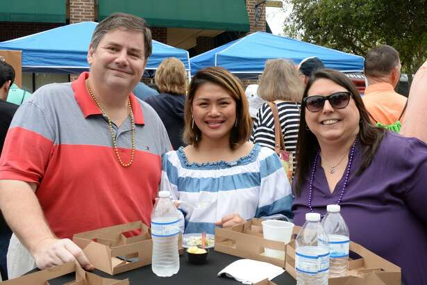 Attendees sample foods from local restaurants during the Katy Taste Fest at Villagio Town Center in Katy, TX on Saturday, March 23, 2019.