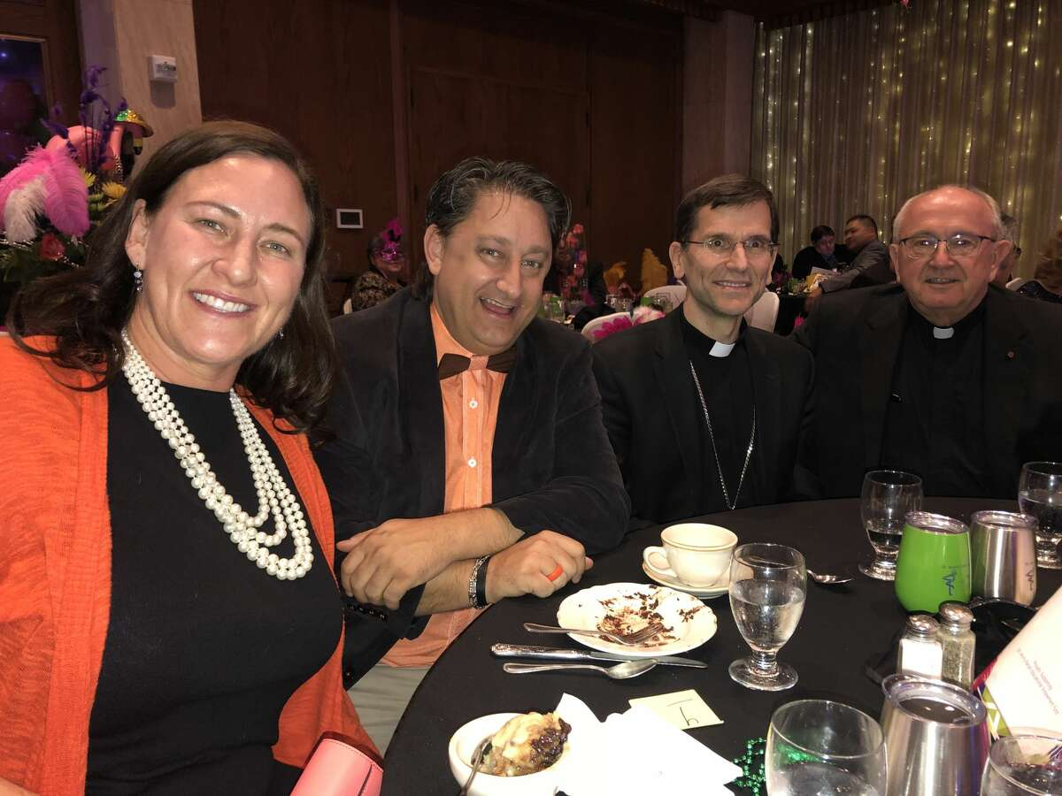Mardi Gras: Emily Kleine, from left, Eric Button, Bishop Michael Sis and Msgr. Larry Droll