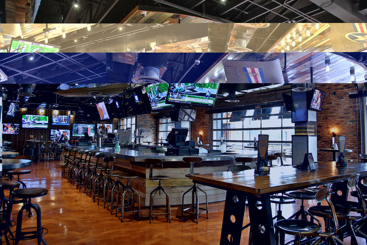 The new Bombshells in Tomball features military memorabilia such as aircraft fighter wings over the bar area.