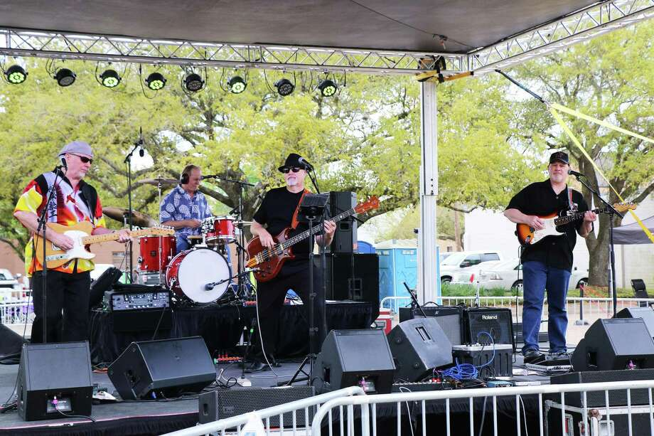 Some early afternoon music on Saturday was provided by the Doc Holliday Band featuring guitarist Dave Miley, Doc Greene on guitar aka Doc Holliday, Troy Nicar on drums and second lead guitarist Jim Rowland. Photo: David Taylor / Staff Photo