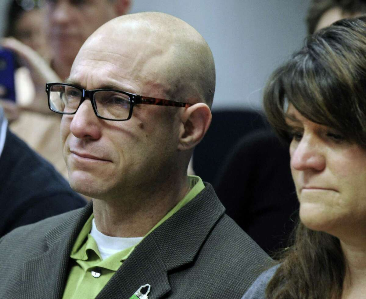 At a 2014 ceremony, Jeremy Richman and Jennifer Hensel watch a video of their daughter, Avielle Richman, a victim of the Sandy Hook School shootings.
