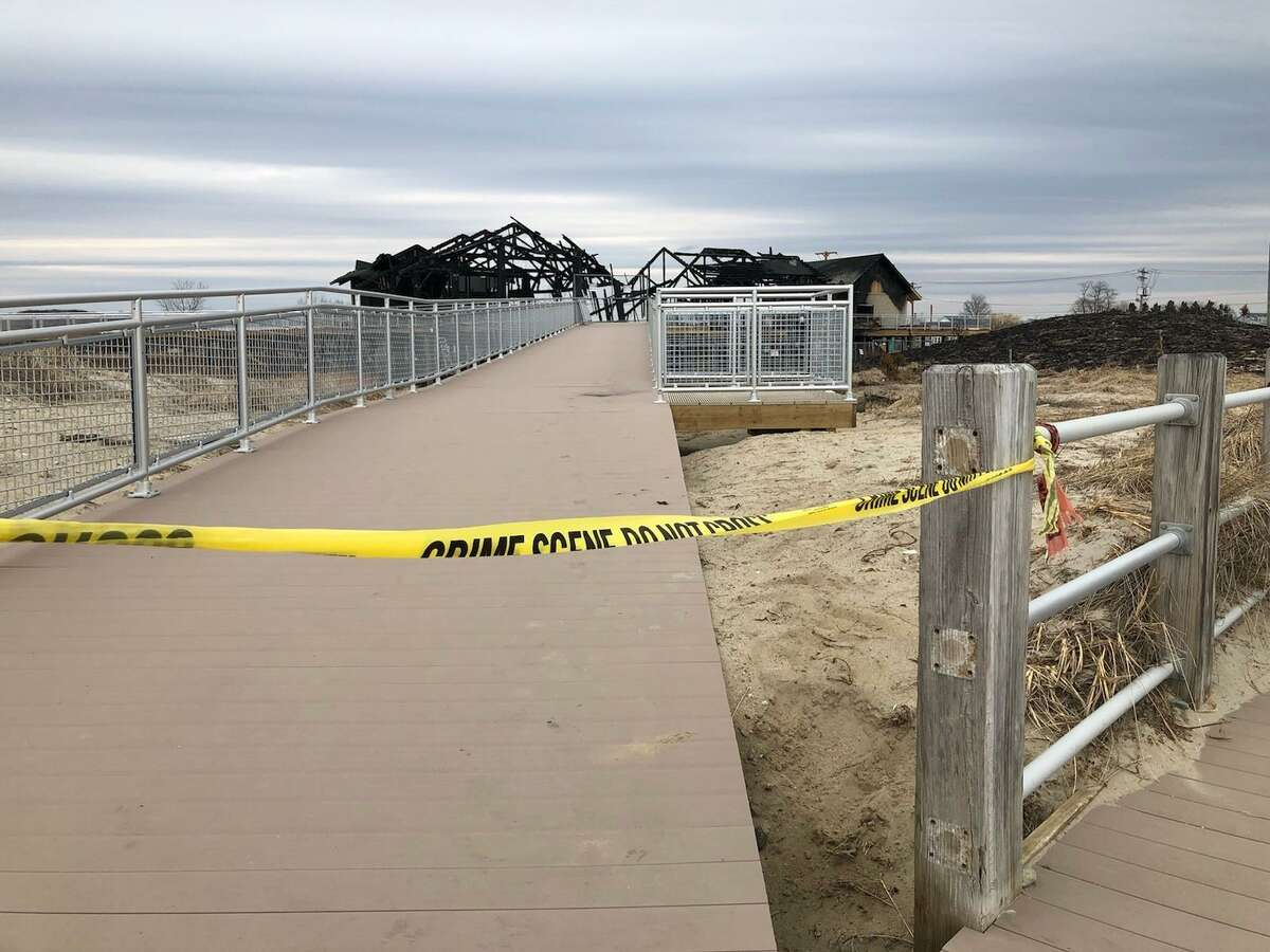 The areas affected by fires at Silver Sands State Park remained cordoned off Monday morning.