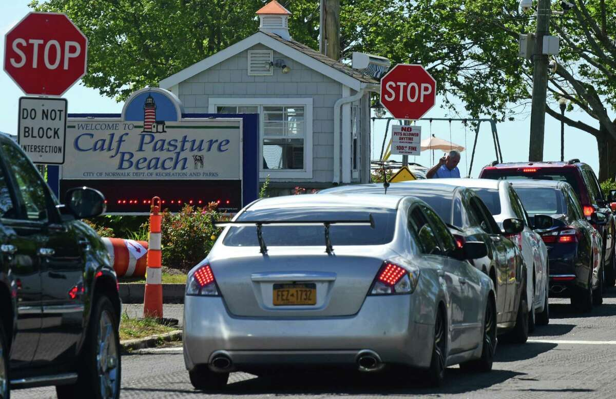 Lines a traffic going into Calf Pasture Beach in Norwalk, Conn. Saturday, July 2, 2016.