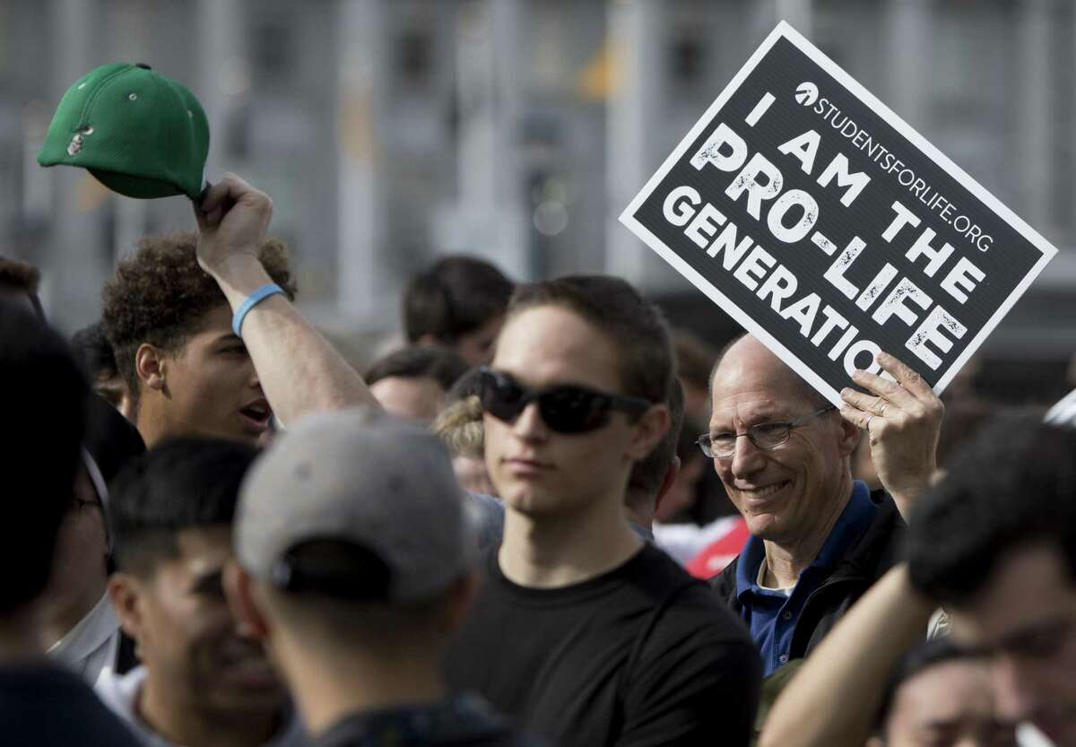 """A demonstrator carries a sign that reads """"I am the Pro-Life generation"""" during the annual anti-abortion Walk for Life event at Civic Center Plaza in San Francisco, Calif. Saturday, Jan. 26, 2019."""